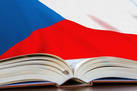 Education in Czech Republic. Opened book and national flag on background. 3D rendered illustration.