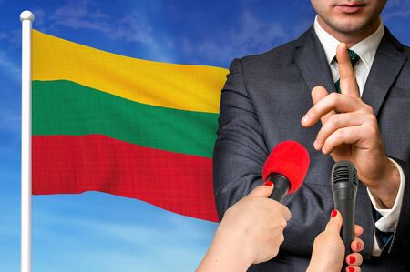 Press conference in Lithuania. Candidate give interview to media. 3D rendered illustration.