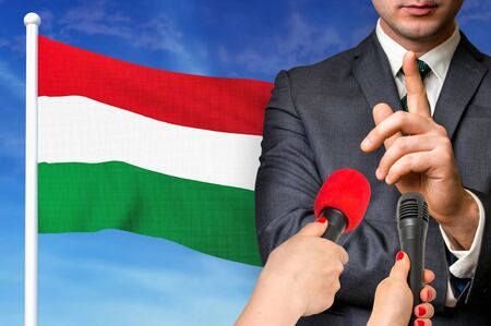 Press conference in Hungary. Candidate give interview to media. 3D rendered illustration.