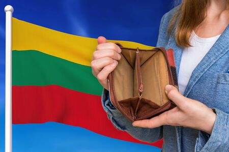 Finance problem in Lithuania. Poor person with empty wallet on national flag background. 版權商用圖片
