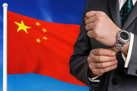 Business in China. Businessman on national flag background.