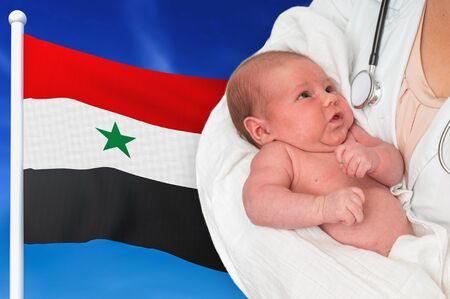 Birth rate in Syria. Newborn baby in hands of doctor on national flag background. Archivio Fotografico - 137885763