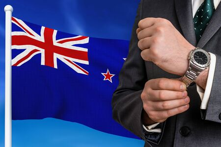Business in New Zealand. Businessman on national flag background.