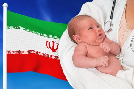 Birth rate in Iran. Newborn baby in hands of doctor on national flag background. Archivio Fotografico - 137885768
