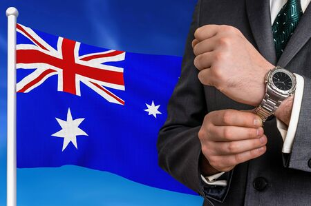 Business in Australia. Businessman on national flag background.