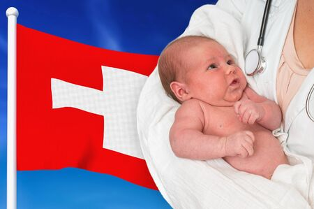 Birth rate in Switzerland. Newborn baby in hands of doctor on national flag background. Archivio Fotografico - 137885820