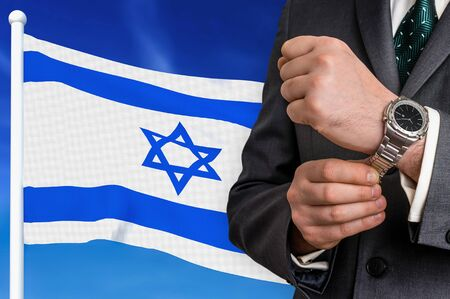 Business in Israel. Businessman on national flag background.