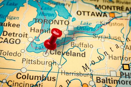PRAGUE, CZECH REPUBLIC - JANUARY 12, 2019: Red thumbtack in a map. Pushpin pointing at Cleveland city in Ohio, America.