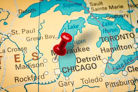 PRAGUE, CZECH REPUBLIC - JANUARY 12, 2019: Red thumbtack in a map. Pushpin pointing at Milwaukee city in Wisconsin, America.