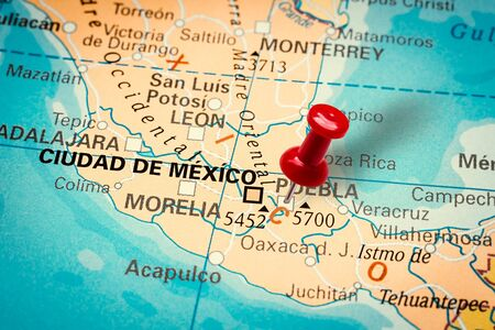 PRAGUE, CZECH REPUBLIC - JANUARY 12, 2019: Red thumbtack in a map. Pushpin pointing at Puebla city in Mexico.