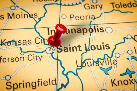 PRAGUE, CZECH REPUBLIC - JANUARY 12, 2019: Red thumbtack in a map. Pushpin pointing at Saint Louis city in Missouri, America.