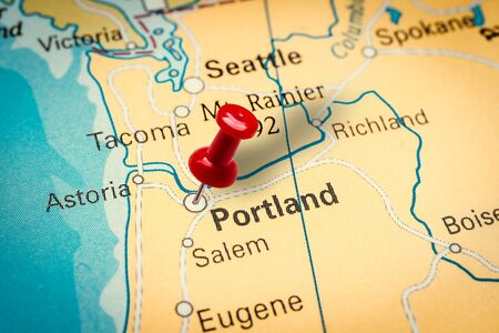 PRAGUE, CZECH REPUBLIC - JANUARY 12, 2019: Red thumbtack in a map. Pushpin pointing at Portland city in Oregon, America.