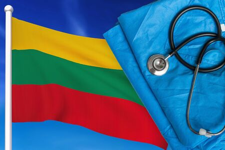 Health care in Lithuania. Stethoscope and medical uniform on national flag background.