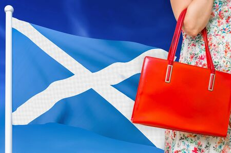 Shopping in Scotland. Woman with red leather bag is shopping in shopping center. Reklamní fotografie