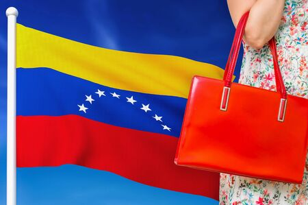Shopping in Venezuela. Woman with red leather bag is shopping in shopping center.