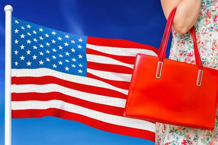 Shopping in United States of America. Woman with red leather bag is shopping in shopping center.