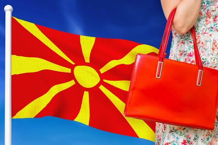 Shopping in Macedonia. Woman with red leather bag is shopping in shopping center. Banco de Imagens