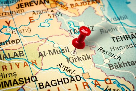 PRAGUE, CZECH REPUBLIC - JANUARY 12, 2019: Red thumbtack in a map. Pushpin pointing at Kirkuk city in Iraq. 版權商用圖片