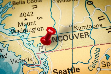 PRAGUE, CZECH REPUBLIC - JANUARY 12, 2019: Red thumbtack in a map. Pushpin pointing at Vancouver city in Canada.