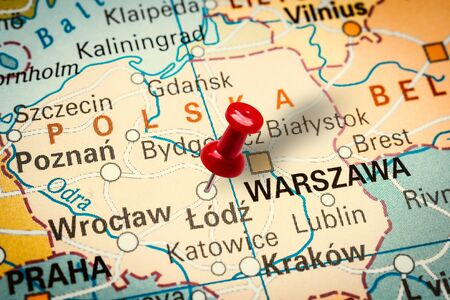 PRAGUE, CZECH REPUBLIC - JANUARY 12, 2019: Red thumbtack in a map. Pushpin pointing at Lodz city in Poland. Stock fotó