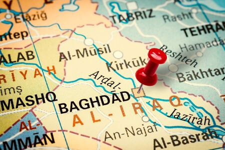 PRAGUE, CZECH REPUBLIC - JANUARY 12, 2019: Red thumbtack in a map. Pushpin pointing at Baghdad city in Iraq. Stock fotó