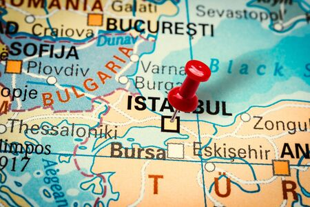 PRAGUE, CZECH REPUBLIC - JANUARY 12, 2019: Red thumbtack in a map. Pushpin pointing at Istanbul city in Turkey.