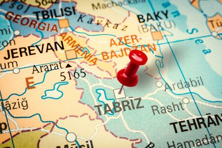 PRAGUE, CZECH REPUBLIC - JANUARY 12, 2019: Red thumbtack in a map. Pushpin pointing at Tabriz city in Iran.