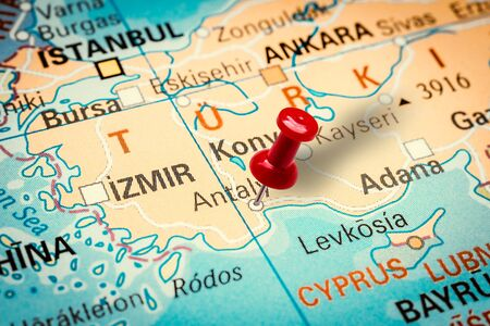 PRAGUE, CZECH REPUBLIC - JANUARY 12, 2019: Red thumbtack in a map. Pushpin pointing at Antalya city in Turkey.