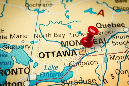 PRAGUE, CZECH REPUBLIC - JANUARY 12, 2019: Red thumbtack in a map. Pushpin pointing at Ottawa city in Canada. Stock fotó