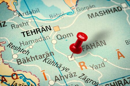 PRAGUE, CZECH REPUBLIC - JANUARY 12, 2019: Red thumbtack in a map. Pushpin pointing at Isfahan city in Iran.
