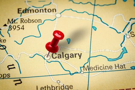 PRAGUE, CZECH REPUBLIC - JANUARY 12, 2019: Red thumbtack in a map. Pushpin pointing at Calgary city in Canada.