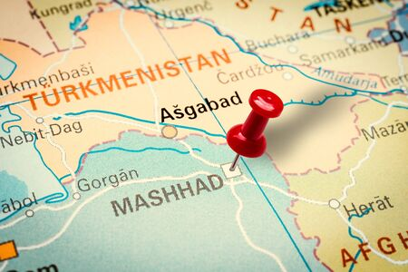 PRAGUE, CZECH REPUBLIC - JANUARY 12, 2019: Red thumbtack in a map. Pushpin pointing at Mashhad city in Iran.
