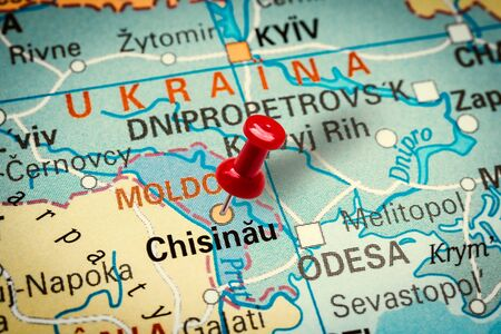 PRAGUE, CZECH REPUBLIC - JANUARY 12, 2019: Red thumbtack in a map. Pushpin pointing at Chisinau city in Moldova. Stock fotó