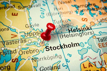PRAGUE, CZECH REPUBLIC - JANUARY 12, 2019: Red thumbtack in a map. Pushpin pointing at Stockholm city in Sweden. Stock fotó