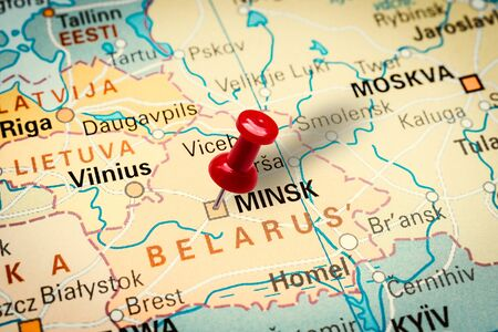 PRAGUE, CZECH REPUBLIC - JANUARY 12, 2019: Red thumbtack in a map. Pushpin pointing at Minsk city in Belarus. Stock fotó