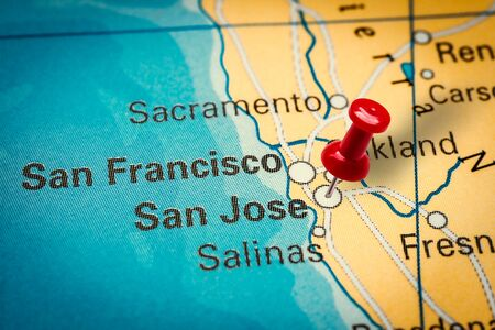 PRAGUE, CZECH REPUBLIC - JANUARY 12, 2019: Red thumbtack in a map. Pushpin pointing at San Jose city in California, America.