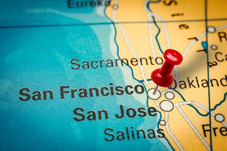 PRAGUE, CZECH REPUBLIC - JANUARY 12, 2019: Red thumbtack in a map. Pushpin pointing at San Francisco city in California, America.