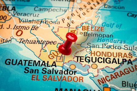 PRAGUE, CZECH REPUBLIC - JANUARY 12, 2019: Red thumbtack in a map. Pushpin pointing at Ciudad de Guatemala city in Guatemala.