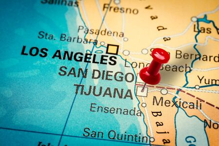 PRAGUE, CZECH REPUBLIC - JANUARY 12, 2019: Red thumbtack in a map. Pushpin pointing at Tijuana city in Baja California, Mexico.