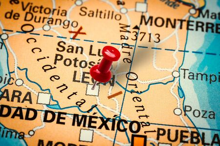 PRAGUE, CZECH REPUBLIC - JANUARY 12, 2019: Red thumbtack in a map. Pushpin pointing at Leon city in Mexico. Sajtókép