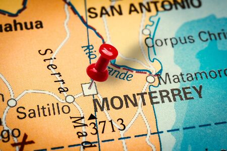 PRAGUE, CZECH REPUBLIC - JANUARY 12, 2019: Red thumbtack in a map. Pushpin pointing at Monterrey city in Mexico.