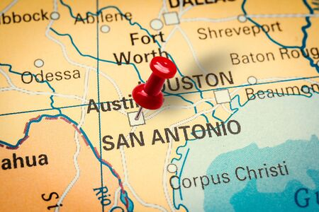 PRAGUE, CZECH REPUBLIC - JANUARY 12, 2019: Red thumbtack in a map. Pushpin pointing at San Antonio city in Texas, America.
