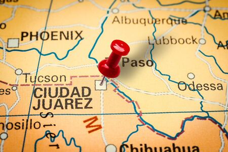 PRAGUE, CZECH REPUBLIC - JANUARY 12, 2019: Red thumbtack in a map. Pushpin pointing at Ciudad Juarez city in Mixico.