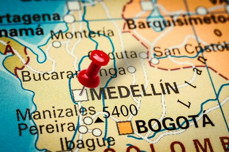 PRAGUE, CZECH REPUBLIC - JANUARY 12, 2019: Red thumbtack in a map. Pushpin pointing at Medellin city in Colombia. Sajtókép