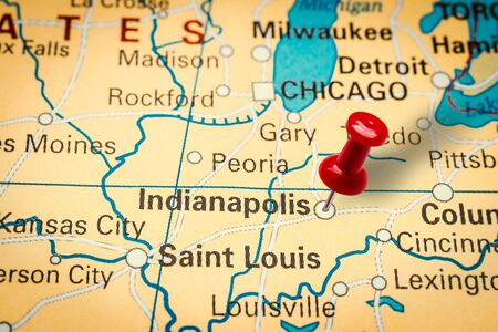 PRAGUE, CZECH REPUBLIC - JANUARY 12, 2019: Red thumbtack in a map. Pushpin pointing at Indianapolis city in Indiana, America.