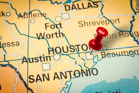 PRAGUE, CZECH REPUBLIC - JANUARY 12, 2019: Red thumbtack in a map. Pushpin pointing at Houston city in Texas, America.