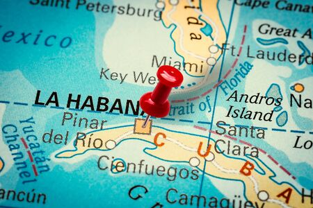 PRAGUE, CZECH REPUBLIC - JANUARY 12, 2019: Red thumbtack in a map. Pushpin pointing at La Habana city in Cuba.