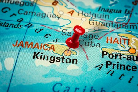 PRAGUE, CZECH REPUBLIC - JANUARY 12, 2019: Red thumbtack in a map. Pushpin pointing at Kingston city in Jamaica. Sajtókép
