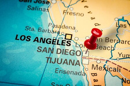 PRAGUE, CZECH REPUBLIC - JANUARY 12, 2019: Red thumbtack in a map. Pushpin pointing at San Diego city in California, America.
