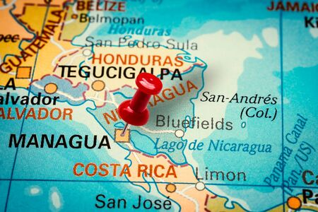 PRAGUE, CZECH REPUBLIC - JANUARY 12, 2019: Red thumbtack in a map. Pushpin pointing at Managua city in Nicaragua.